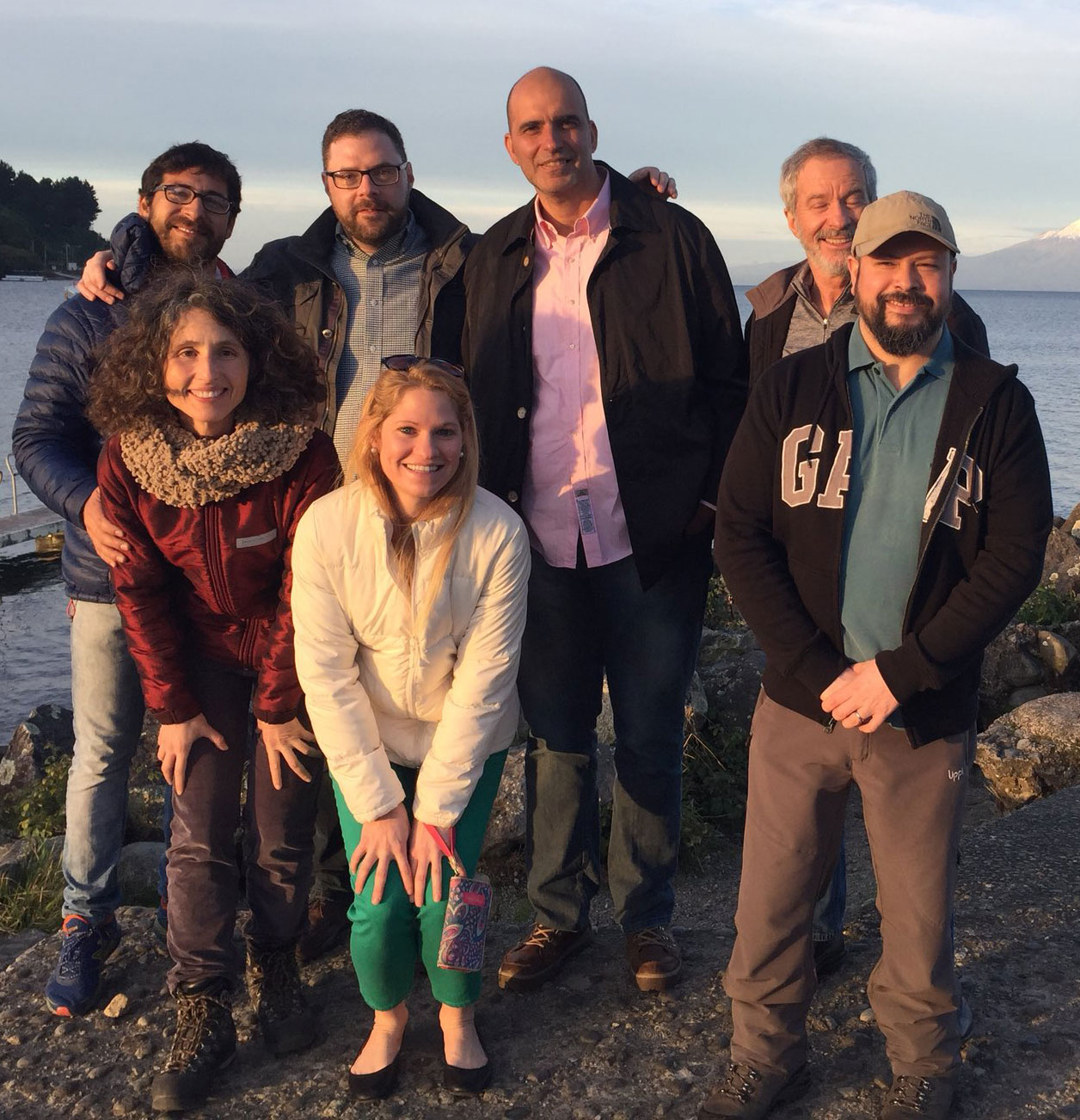 UMN faculty and researchers in Puerto Varas, Chile smiling at the camera