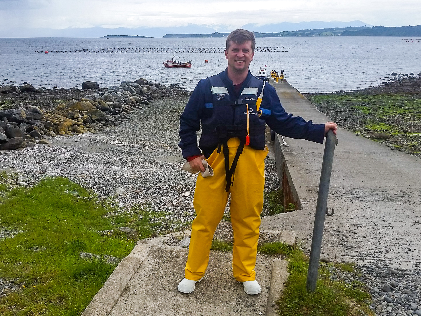 Gil Patterson standing in front of aquaculture farms